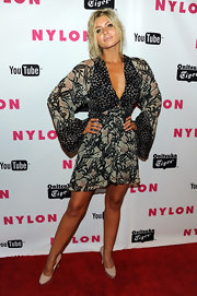 Alyson Michalka paired her kimono style mini dress with cream patent platforms.