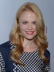 Claire Coffee added a touch of muted red lipstick to give her look a retro vibe.