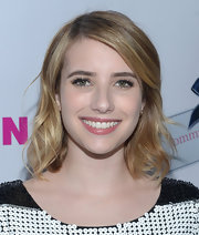 Emma Roberts attended 'Nylon' magazine's annual young Hollywood issue wearing her layered 'do in soft waves.
