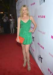Jessy Schram laced up some cool strappy suede sandals before she hit the red carpet at the 'Nylon' magazine celebration of the young Hollywood issue.