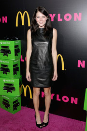 Emma Greenwell donned a simple yet stylish leather LBD for the Nylon issue party.