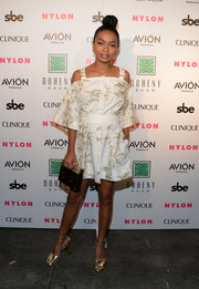 Yara Shahidi complemented her mini dress with chic gold platform sandals.