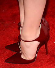 Chloe Grace Moretz chose a pair of crimson red pointy toe pumps with a bow-detailed T-strap for her red carpet look.