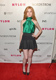This black fit-and-flare skirt topped off Katherine McNamara's flirty red carpet look.