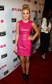 Olivia Holt opted for this hot pink leather dress for her feminine but edgy red carpet look.