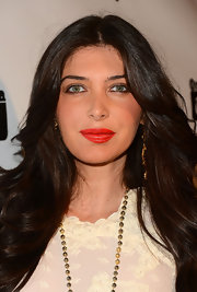 Instead of going for the typical red lip, Brittny Gastineau opted for a bold orange lip color!