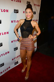 Lindsey Morgan showed off her fit figure with this black lace halter top, which she paired with multi-colored shorts.