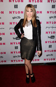 Debby added a edgy touch to her metallic skirt with a cropped leather jacket. Ankle strap heels completed her look.