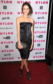 "The actress wore a ruched black dress with edgy accessories, including a pair of strappy, peep-toed ""Quacker"" ankle boots."