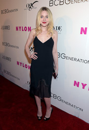 Dakota Fanning showed her sultry side in a clingy sheer-hem LBD by Stella McCartney during the Nylon Young Hollywood Party.