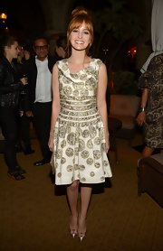 Ahna O'Reilly paired her printed frock with shiny champagne heels featuring glitzy jewel-toned embellishments.