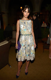 Jordana Brewster added a pop of color to her look with this rich purple silk clutch.