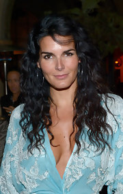 Angie Harmon attended a private dinner given by Naeem Khan wearing her long locks in beachy waves.