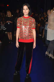 Leigh Lezark teamed her top with black side-striped velvet pants, also by Naeem Khan.