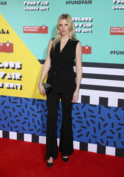 Lara Stone kept it simple yet smart in a sleeveless black pantsuit by Givenchy at the Naked Heart Foundation's Fabulous Fund Fair.