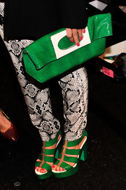 Nastia Liukin's green accessories like this Kelly green over-sized clutch, added some pop to her look at the Nanette Lepore runway show.
