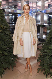 Carolyn Murphy showed off an ultra-chic fur trenchcoat at the 'Close Your Eyes and Think of Christmas' event.