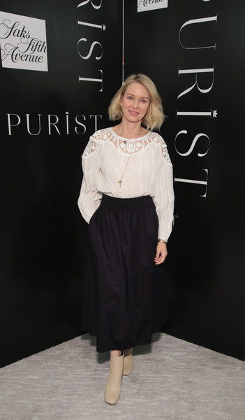 Naomi Watts Ankle Boots [clothing,shoulder,fashion,dress,joint,cocktail dress,footwear,premiere,waist,flooring,naomi watts,purist host wellness panel discussion,saks fifth avenue,new york city,purist host wellness panel discussion]