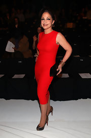 Gloria Estefan wore a red sheath dress for the front row of Narciso Rodriguez.