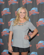 Nastia Liukin visited Planet Hollywood wearing a beaded neckline tee and a pair of plaid short shorts.
