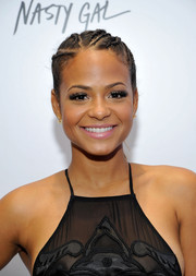 Christina Milian looked hip with her cornrow ponytail at the Nasty Gal Melrose store launch.
