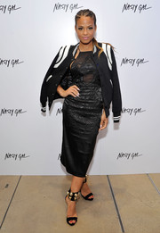 Christina Milian looked totally red carpet-ready in an embroidered, sheer-panel LBD during the Nasty Gal Melrose store launch.