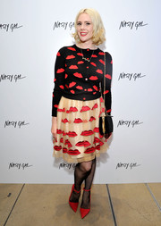 Kate Nash added an extra pop of red with a pair of pointy ankle-strap pumps.