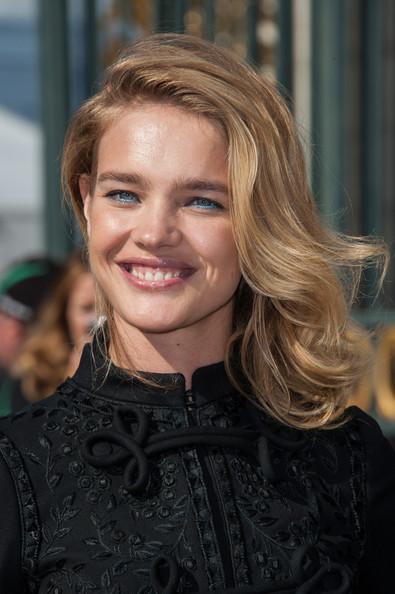 Natalia Vodianova Bright Eyeshadow [hair,blond,hairstyle,eyebrow,layered hair,beauty,chin,brown hair,smile,lip,natalia vodianova,part,summer 2013,paris,france,valentino spring,espace ephemere tuileries,valentino: arrivals - paris fashion week womenswear spring,show,paris fashion week]