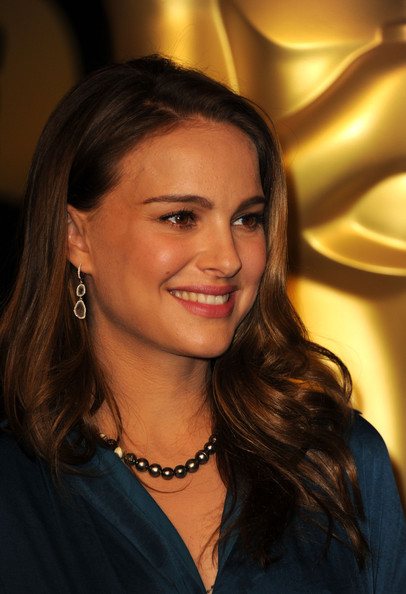 Natalie Portman Dangling Gemstone Earrings [hair,face,hairstyle,eyebrow,beauty,chin,smile,long hair,brown hair,layered hair,arrivals,natalie portman,83rd academy awards,california,beverly hills,beverly hilton hotel,luncheon,nominations luncheon]