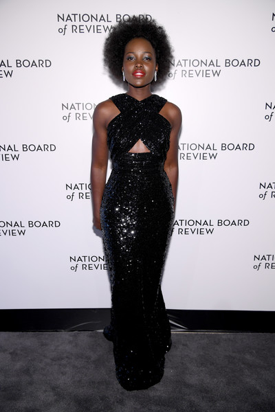 Lupita Nyong'o looked ultra glam in a black sequined cutout gown by Celine at the 2020 National Board of Review Awards Gala.