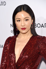 Constance Wu finished off her monochromatic look with a pair of red gemstone drop earrings by Anabela Chan.