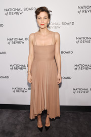Maggie Gyllenhaal looked simply chic in a nude A.W.A.K.E. Mode dress with a pleated skirt and a high-low hem at the National Board of Review Awards Gala.