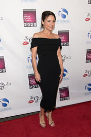 Julia Louis-Dreyfus polished off her look with gold ankle-strap sandals.