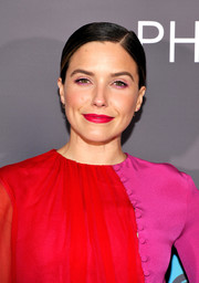 Sophia Bush sported red lipstick and pink eyeshadow to match her outfit.