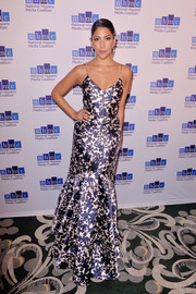 Stephanie Beatriz looked vibrant and glam in a printed mermaid gown by ML Monique Lhuillier at the Impact Awards.