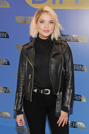 Ashley Benson layered a semi-sheer black turtleneck under a leather jacket for the national launch of Differin Gel.