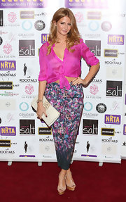 Millie Mackintosh donned a stylish outfit wearing a tied sheer top and floral pants at the National Reality TV awards in London.