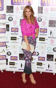 Millie Mackintosh completed her overall look with the right choice of soles - Louboutin nude T-strap wedges that is - at the National Reality TV awards.