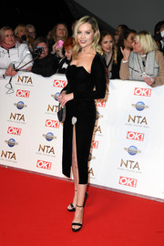 Laura Whitmore went the flirty-glam route in a high-slit black velvet dress at the 2020 National Television Awards.