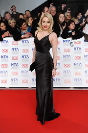 Lydia Bright wore a sleek black satin gown for walking the red carpet at the National Television Awards.