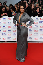 Lauren Goodger looked sharp in a glittering silver gown with a deep-plunge at the National Television Awards.
