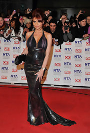 Amy is a seductress in a metallic evening dress at the National Television Awards.