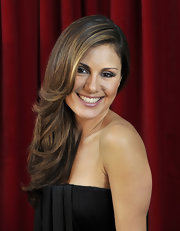German TV presenter Nazan Eckes, highlighted her face with a few carmel colored highlights in her long brunette locks.