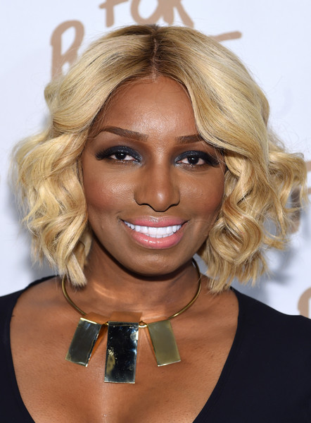 NeNe Leakes Short Curls [hair,face,blond,hairstyle,chin,eyebrow,beauty,lip,layered hair,bob cut,arrivals,naomi campbell,nene leakes,lincoln center,new york city,the theatre,fashion for relief charity fashion show,mercedes-benz fashion week]