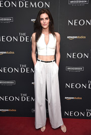 Hilary Rhoda flashed her taut abs in a white zip-front leather crop-top by Alexander Wang at the New York premiere of 'The Neon Demon.'