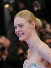 Elle Fanning went for old-school elegance with this center-parted bun at the Cannes screening of 'The Neon Demon.'
