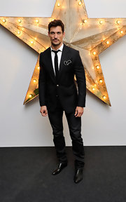 David Gandy poses for photographers at the Dolce & Gabbana party.