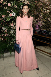 Alexa Chung pulled her look together with a metallic blue box purse.
