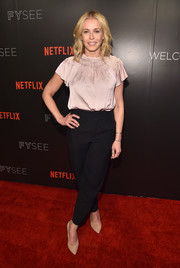 Chelsea Handler went demure in a pink silk blouse with flutter sleeves and a smocked neckline at the Netflix Comedy Panel FYC event.