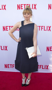 Natasha Lyonne opted for a modern look with this asymmetrical navy midi dress when she attended the Netflix Emmy season casting event.